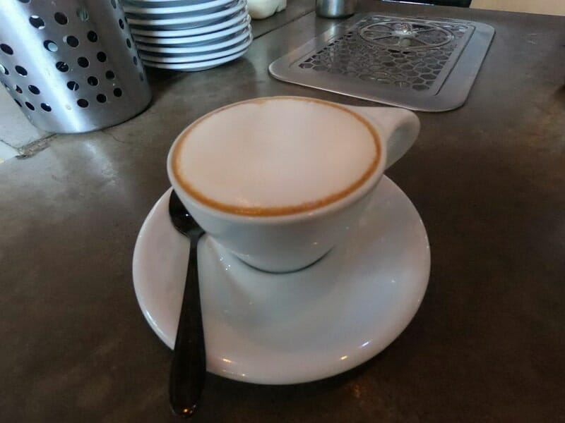 Cappuccino Coffee served in a white cup and saucer