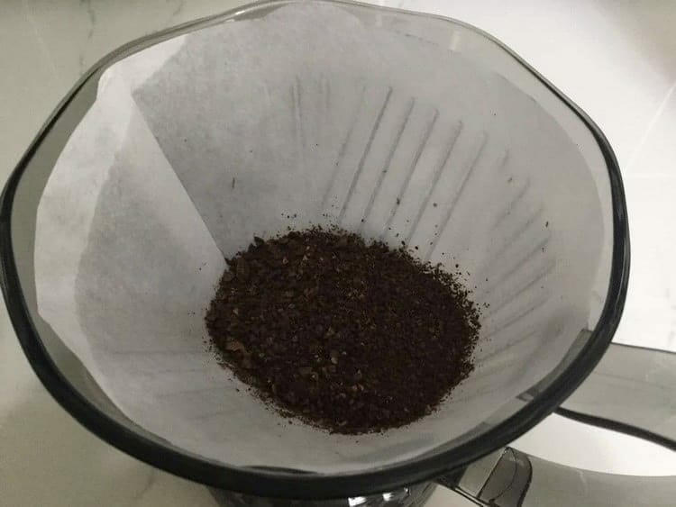 Add Your Ground Coffee To The Dripper